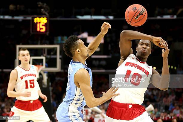 Nigel Hayes of the Wisconsin Badgers looses the ball alongside JP Tokoto of the North Carolina Tar Heels in the first half during the West Regional...
