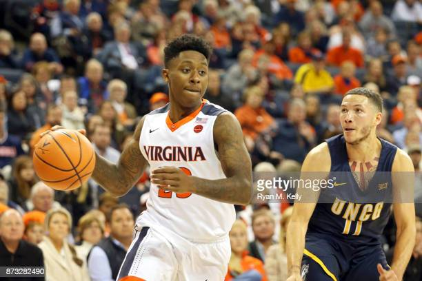 Nigel Johnson of the Virginia Cavaliers drives past Demetrius Troy of the North Carolina Greensboro Spartans in the second half during a game at John...