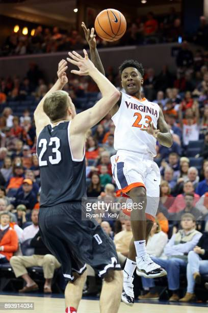 Nigel Johnson of the Virginia Cavaliers shoots over Peyton Aldridge of the Davidson Wildcats in the first half during a game at John Paul Jones Arena...