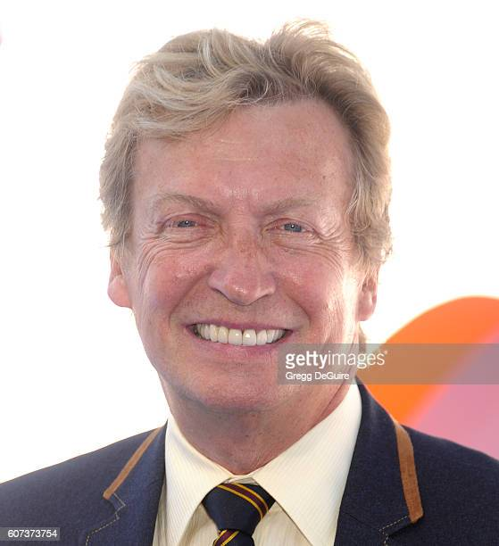 Nigel Lythgoe arrives at the premiere of Warner Bros Pictures' 'Storks' at Regency Village Theatre on September 17 2016 in Westwood California