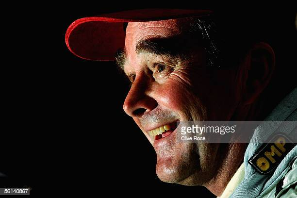 Nigel Mansel of Great Britain laughs during a press conference after Practice prior to the Grand Prix Masters race at the Kyalami Circuit on November...