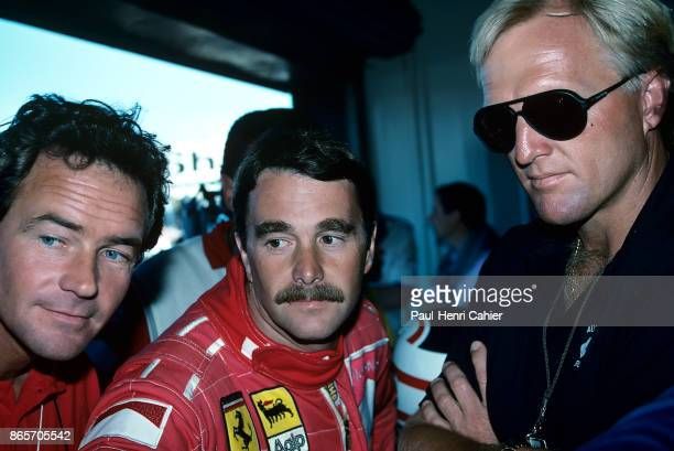 Nigel Mansell Barry Sheene Greg Norman Grand Prix of Great Britain Silverstone Circuit 15 July 1990 Nigel Mansell with Motorcycle Grand Prix legend...