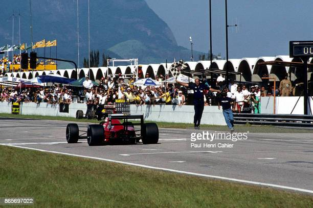 Nigel Mansell Cesare Fiorio Ferrari 640 Grand Prix of Brazil Jacarepagua 26 March 1989 Checkered flag and victory for Nigel Mansell for his race for...