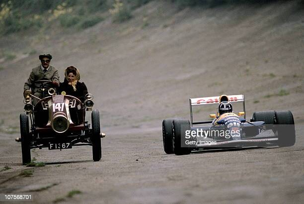 Nigel Mansell, driver of the Canon Williams Renault Williams FW14B Renault 3.5 V10 takes a drive with his wife Roseanne in a 1902 Renault along the...