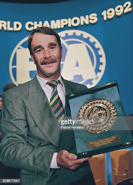 Nigel Mansell driver of the Canon Williams Renault Williams FW14B Renault V10 receives his F1 World Drivers Championship award during the Federation...