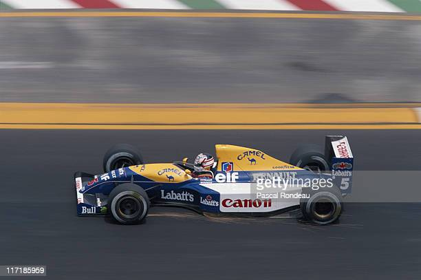 Nigel Mansell drives the Canon Williams Renault Williams FW14 Renault V10 with sparks trailing from the underside of the car during the Mexican Grand...