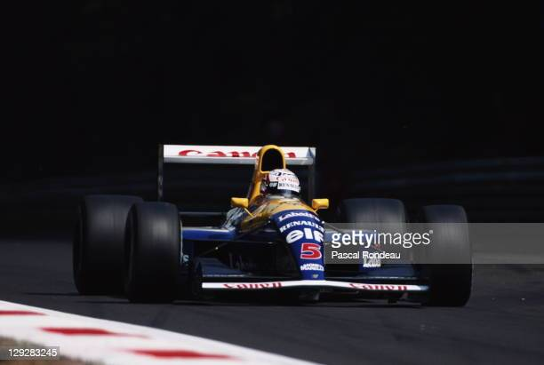 Nigel Mansell drives the Canon Williams Renault Williams FW14 Renault 35 V10 during the Coca Cola Italian Grand Prix on 8th September 1991at the...