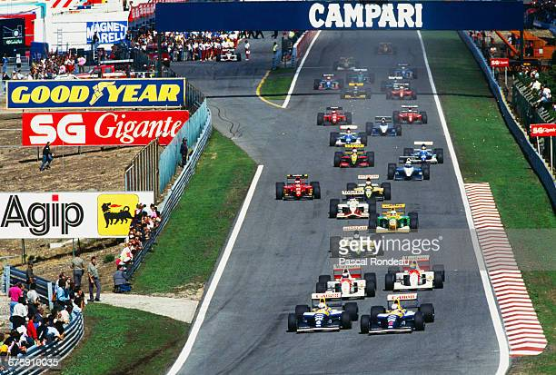 Nigel Mansell drives the Canon Williams Renault Williams FW14 Renault 3.5 V10 ahead of team mate Riccardo Patrese at the start of the Portuguese...