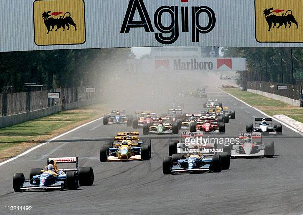 Nigel Mansell drives the Canon Williams Renault Williams FW14B Renault 3.5 V10 ahead of the field at the start of the Mexican Grand Prix on 22nd...