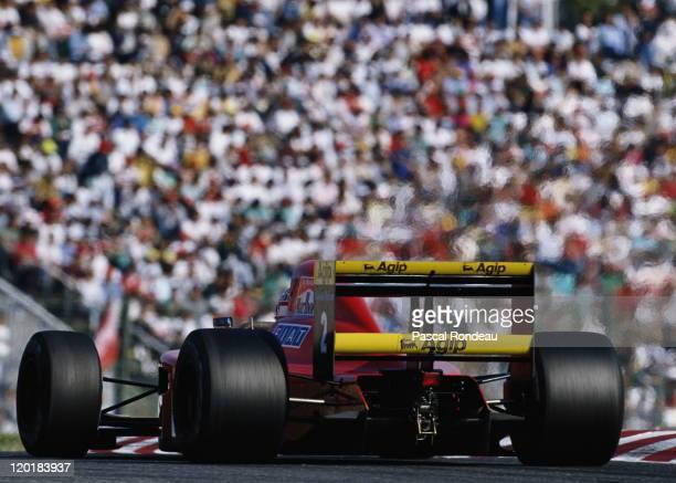 Nigel Mansell drives the Scuderia Ferrari SpAFerrari F1902 Ferrari 35 V12 during the Fuji Television Japanese Grand Prix on 21st October 1990 at the...