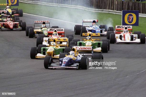 Nigel Mansell in the WilliamsRenault briefly behind teammate Riccardo Patrese at Copse on his way to winning the British Grand Prix Great Britain's...