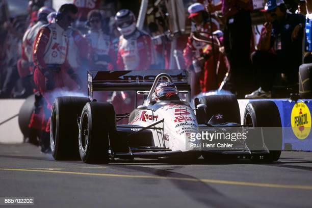 Nigel Mansell, Lola T93/06 Ford XB Cosworth, Australian IndyCar Grand Prix, Surfers Paradise, 21 March 1993. Pit stop and wheel spin for Niigel...
