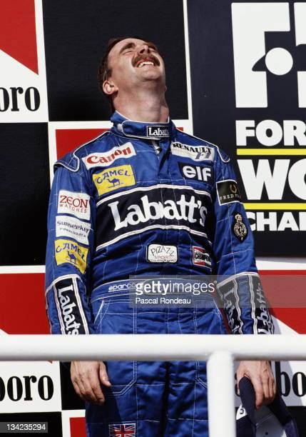 Nigel Mansell of Great Britain and driver of the Canon Williams Renault Williams FW14B Renault 35 V10 after winning the Formula One World Drivers...