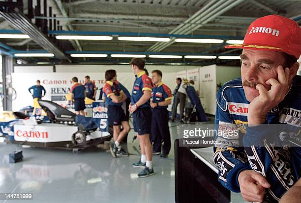 Nigel Mansell of Great Britain and driver of the Canon Williams Renault Williams FW14 Renault 35 V10 after it is announced he is retiring from motor...