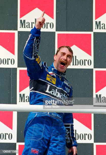 BUDAPEST HUNGARY August 16 1992 Nigel Mansell of Great Britain celebrates clinching the Drivers' Championship after finishing 2nd in the Hungarian...