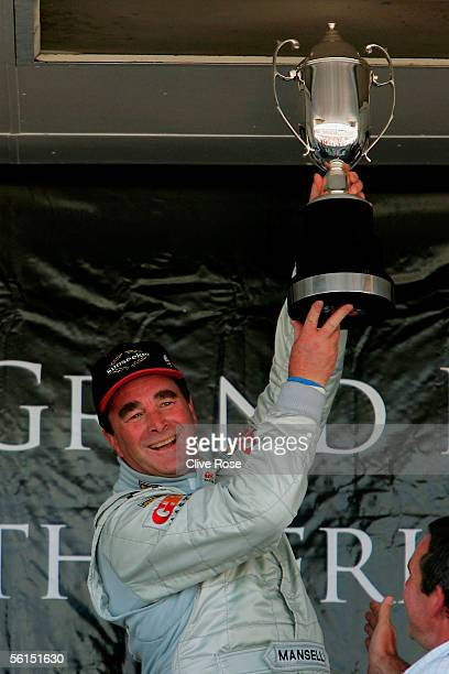 Nigel Mansell of Great Britain celebrates winning the Grand Prix Masters race at the Kyalami Circuit on November 13 2005 in Johannesburg South Africa