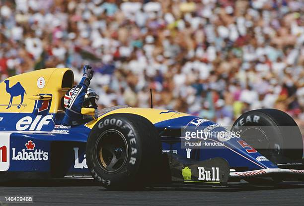 Nigel Mansell of Great Britain driver of the Canon Williams Renault Williams FW14B Renault V10 salutes his victory in the Mobil 1 German Grand Prix...