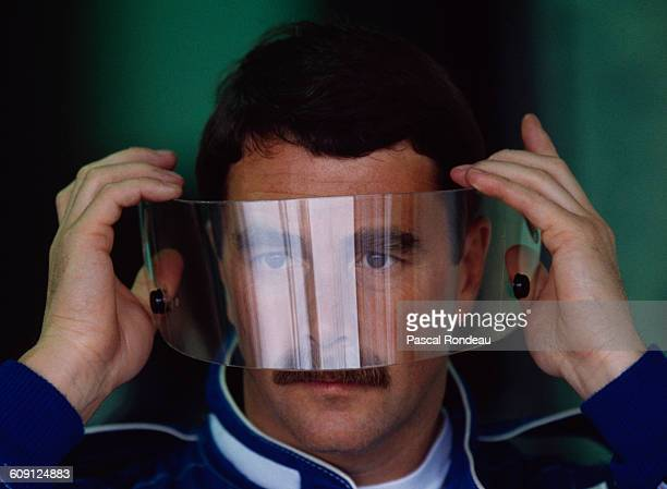 Nigel Mansell of Great Britain driver of the Canon Williams Renault Williams FW14 Renault RS3C V10 looks through his visor before the the Canadian...