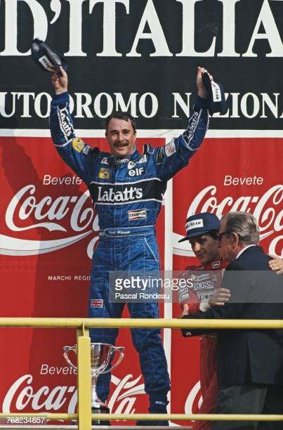 Nigel Mansell of Great Britain driver of the Canon Williams Renault Williams FW14Renault V10 salutes the crowd and celebrates his win as JeanMarie...