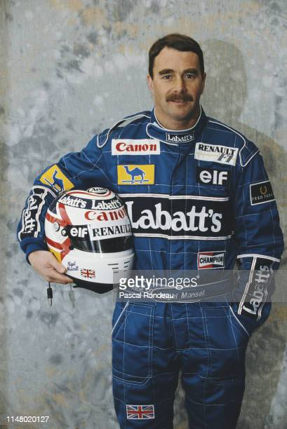 Nigel Mansell of Great Britain driver of the Canon Williams Team Williams FW14 Renault RS3 V10 poses for a portrait during pre season testing on 1...