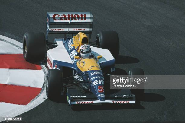Nigel Mansell of Great Britain drives the Canon Williams Renault Williams FW14 Renault V10 during practice for the French Grand Prix on 6th July 1991...