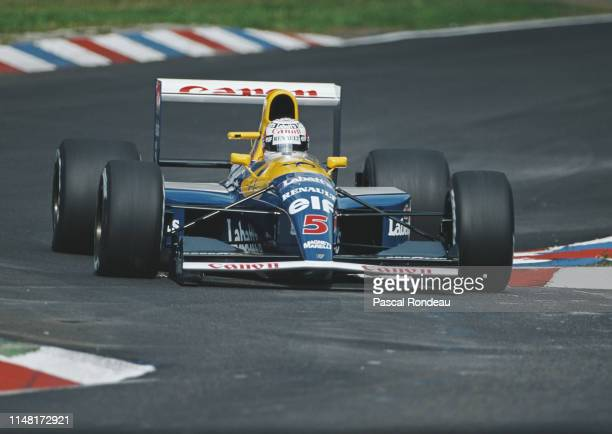 Nigel Mansell of Great Britain drives the Canon Williams Renault Williams FW14B Renault V10 during practice during for the Mobil 1 German Grand Prix...