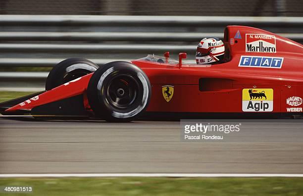 Nigel Mansell of Great Britain drives the Scuderia Ferrari SpA Ferrari 641 Ferrari 036 V12 during the San Marino Grand Prix on 23rd April 1989 at the...