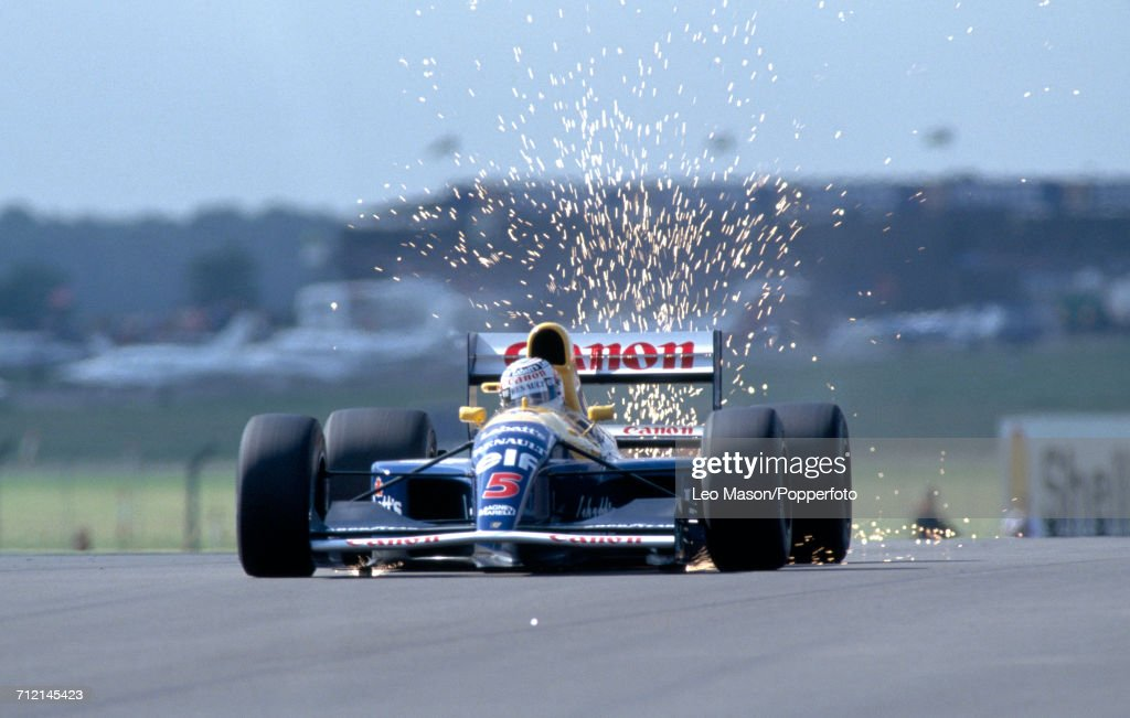 Nigel Mansell of Great Britain enroute to a first place finish, driving a #5 Williams FW14 with a Renault RS3 3.5 V10 engine for the Canon Williams Renault Team, during the British Grand Prix at Silverstone, England on 14th July 1991.