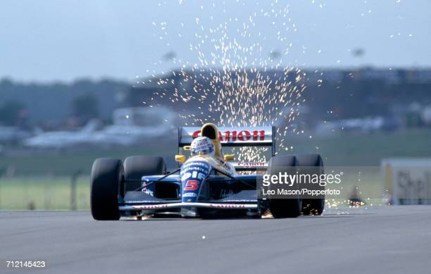 Nigel Mansell of Great Britain enroute to a first place finish driving a Williams FW14 with a Renault RS3 35 V10 engine for the Canon Williams...