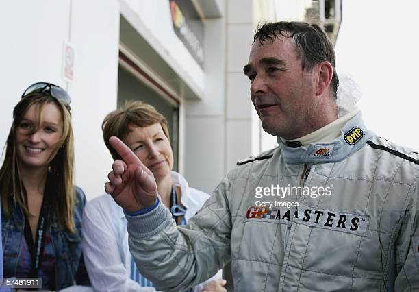Nigel Mansell of Great Britain in the pitlane with his with Rosanne Mansell and Chloe Mansell during practice ahead of the Grand Prix Masters at...