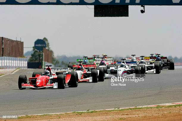 Nigel Mansell of Great Britain leads from the start of the Grand Prix Masters race at the Kyalami Circuit on November 13 2005 in Johannesburg South...