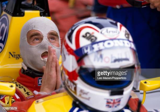 Nigel Mansell of Great Britain puts his hands together in a prayerful attitude prior to driving the Williams FW11B with a Honda RA167E 15 V6t engine...