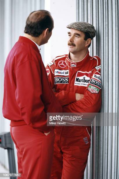 Nigel Mansell of Great Britain talks to McLaren managing director Ron Dennis during a break in testing at the Estoril circuit on March 7 1995 in...