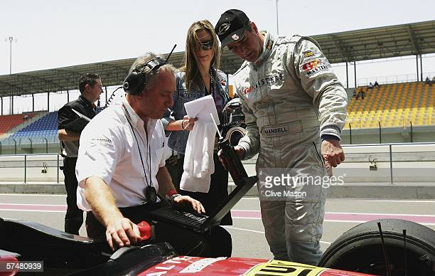 Nigel Mansell of Great Britain talks with his daughter Chloe and his engineer after third official practice prior to the Grand Prix Masters race at...