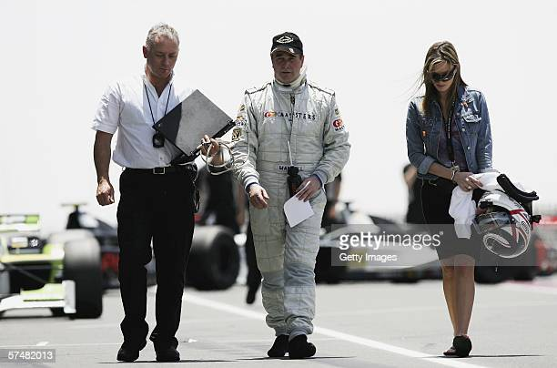 Nigel Mansell of Great Britain walks down the pitlane with a race engineer and his daughter Chloe Mansell during practice ahead of the Grand Prix...