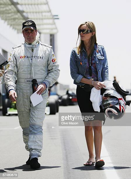 Nigel Mansell of Great Britain walks down the pitlane with his daughter Chloe after third official practice prior to the Grand Prix Masters race at...