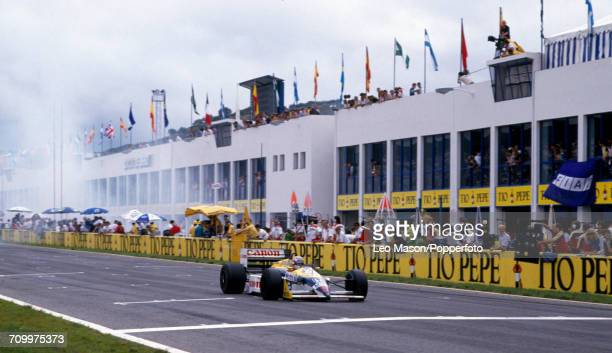 Nigel Mansell of Great Britain wins the Spanish Grand Prix driving a Williams FW11B with a Honda RA167E 15 V6t engine for Canon Williams Honda in...