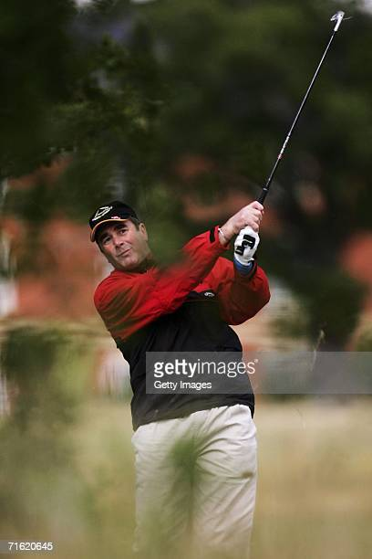Nigel Mansell plays a shot at Whittlebury Park Golf and Country Club prior to testing for the GP Masters of Great Britain at Silverstone circuit on...