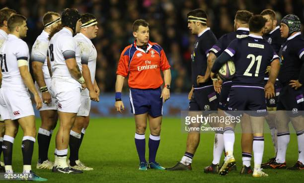Nigel Owens referee talks to the front row during the NatWest Six Nations Championship between Scotland and England at Murrayfield on February 24...