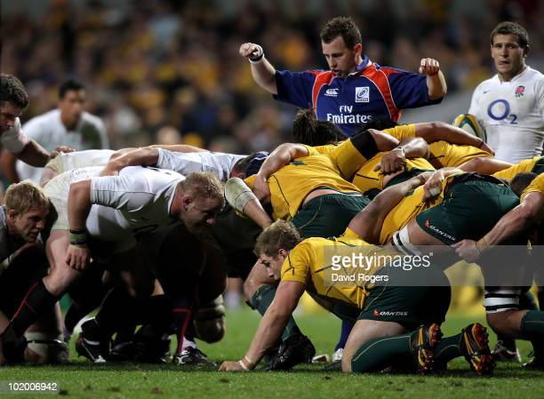 Nigel Owens the referee keeps a close watch on the packs after the Australian Wallabies collapse the scrum during the Cook Cup Test match between the...