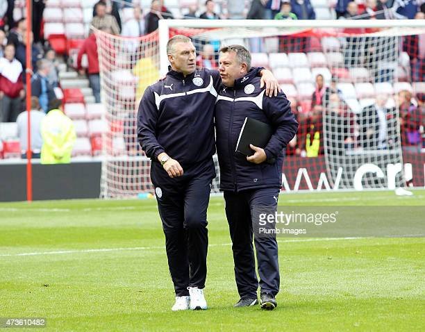 Nigel Pearson and Craig Shakespeare of Leicester City celebrate their premier league survival after the Premier league match between Sunderland and...