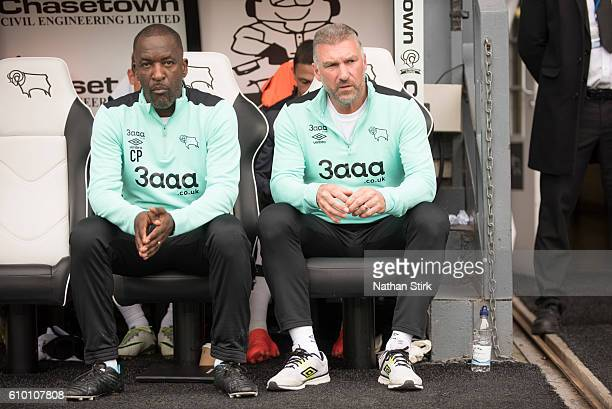 Nigel Pearson manager of Derby County and assistant manager Chris Powell look on during the Sky Bet Championship match between Derby County and...