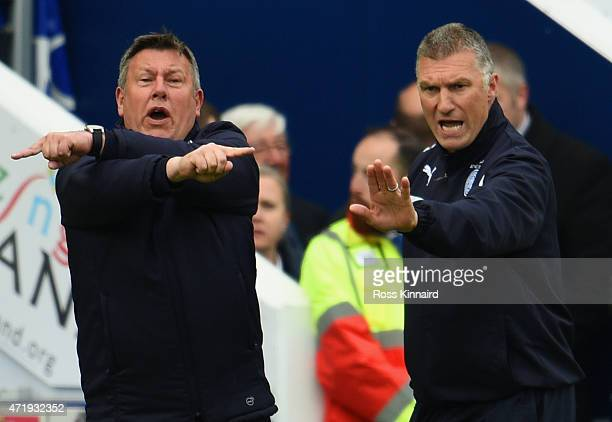 Nigel Pearson , manager of Leicester City and Craig Shakespeare , Assistant Manager of Leicester City gesture during the Barclays Premier League...