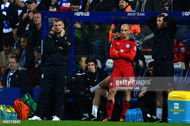 Nigel Pearson manager of Leicester City and Esteban Cambiasso react on the touch line during the Barclays Premier League match between Queens Park...