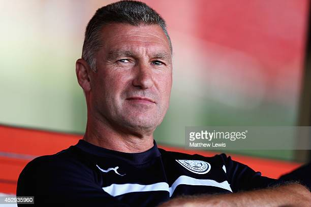 Nigel Pearson manager of Leicester City looks on during the Pre Season Friendly match between Walsall and Leicster City at Banks' Stadium on July 30...