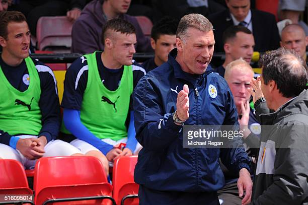 Nigel Pearson manager of Leicester City shakes with Gianfranco Zola manager of Watford prior to the game as in the background Harry Kane and Jamie...