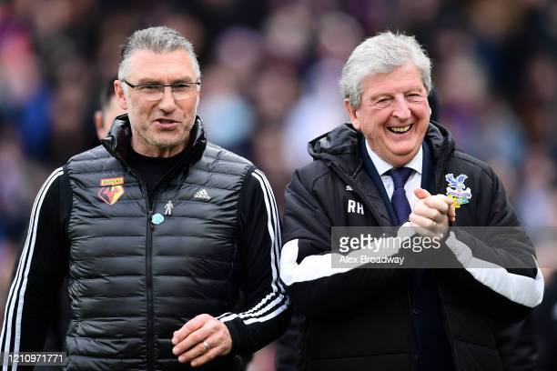 Nigel Pearson, Manager of Watford and Roy Hodgson, Manager of Crystal Palace react prior to the Premier League match between Crystal Palace and...