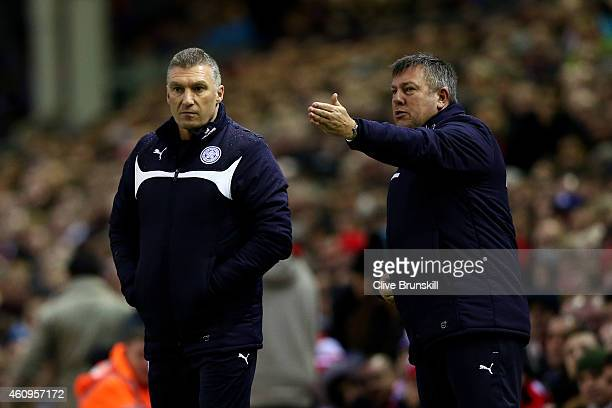 Nigel Pearson the manager of Leicester City and Craig Shakespeare the assistant manager of Leicester City react during the Barclays Premier League...