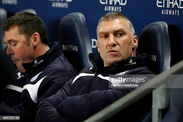 Nigel Pearson the manager of Leicester City looks on during the Barclays Premier League match between Manchester City and Leicester City at the...