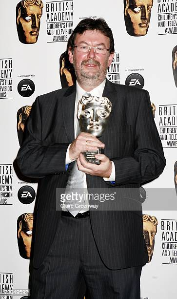 Nigel Pickard poses with the Special Award for his outstanding contribution to children's television in the awards room at the 11th British Academy...